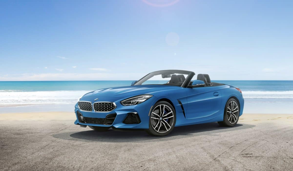 BMW Z4 at the beach with the top down.