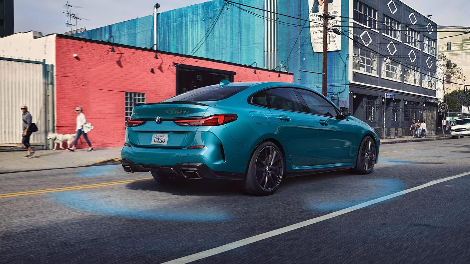 BMW 2 Series Gran Coupe in an urban backdrop.