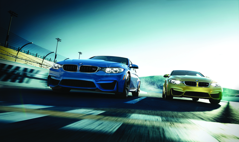 BMW M Series 4 Coupe and Convertible on an open track.