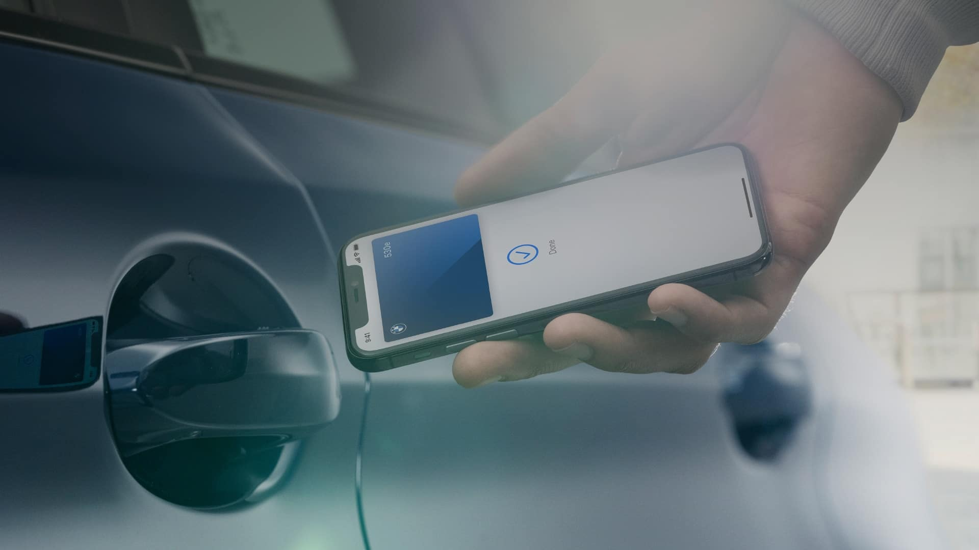 Person opening a BMW door with their BMW Digital Key for iPhone