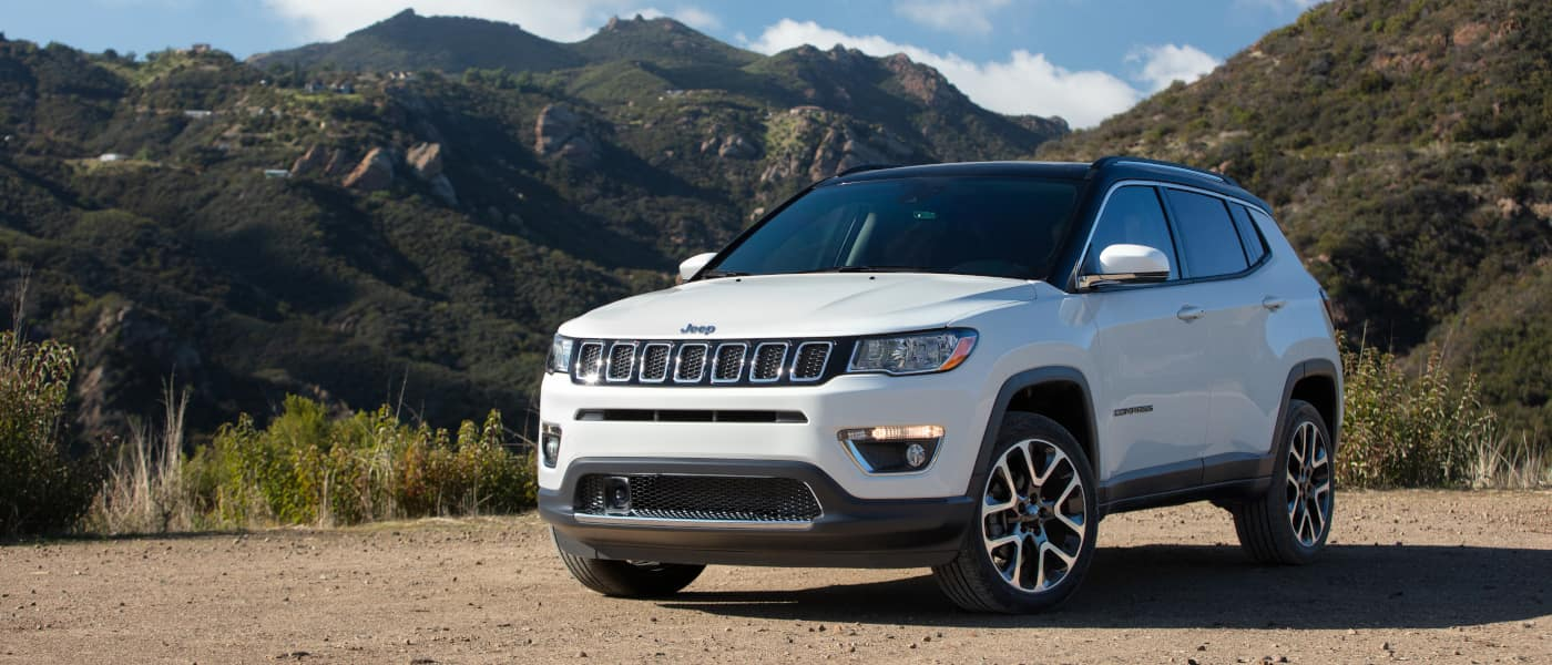 2021 Jeep Compass driving on a dirt road