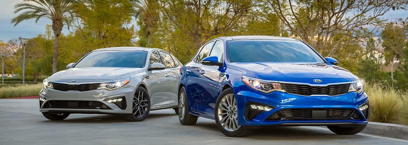 2019 kia optima blue and silver parked