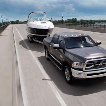 2018 Ram 2500 Limited towing a boat down highway