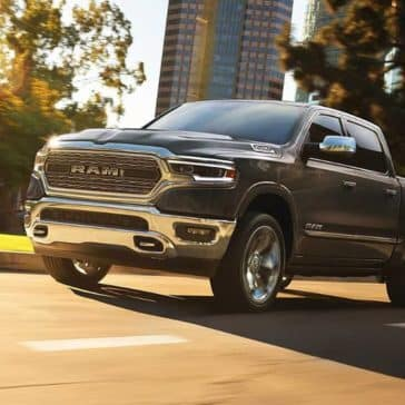 2019 Ram 1500 drives down city street