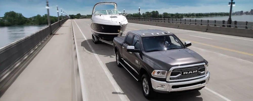 ram 2500 towing boat down highway