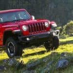 2019 red wrangler in open field