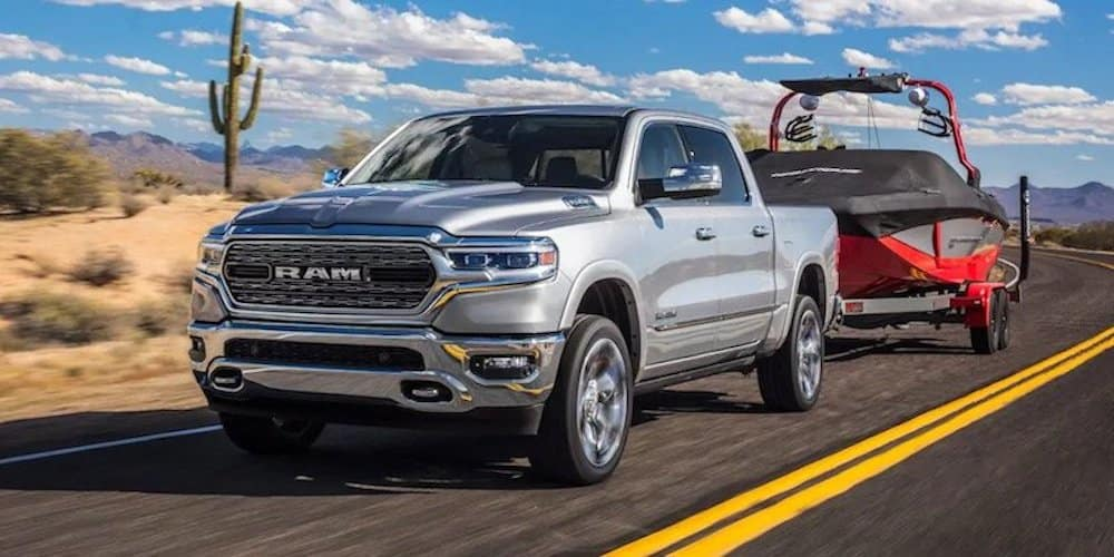 2019 ram 1500 towing boat on highway