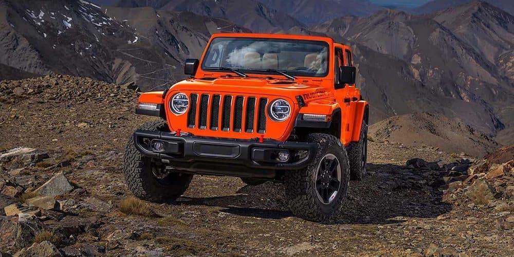 Orange 2019 Jeep Wrangler Rubicon on Mountain