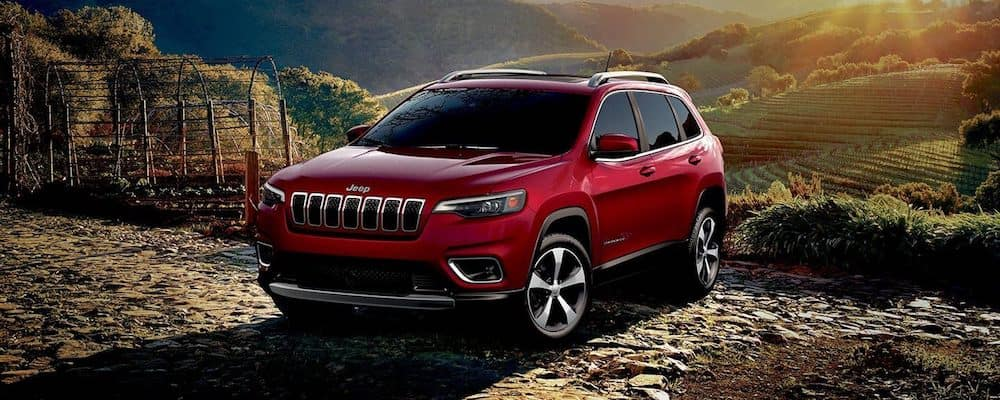 Red 2019 Jeep Cherokee Parked on Rocks