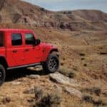 Red 2020 Jeep Gladiator Parked On Rocks