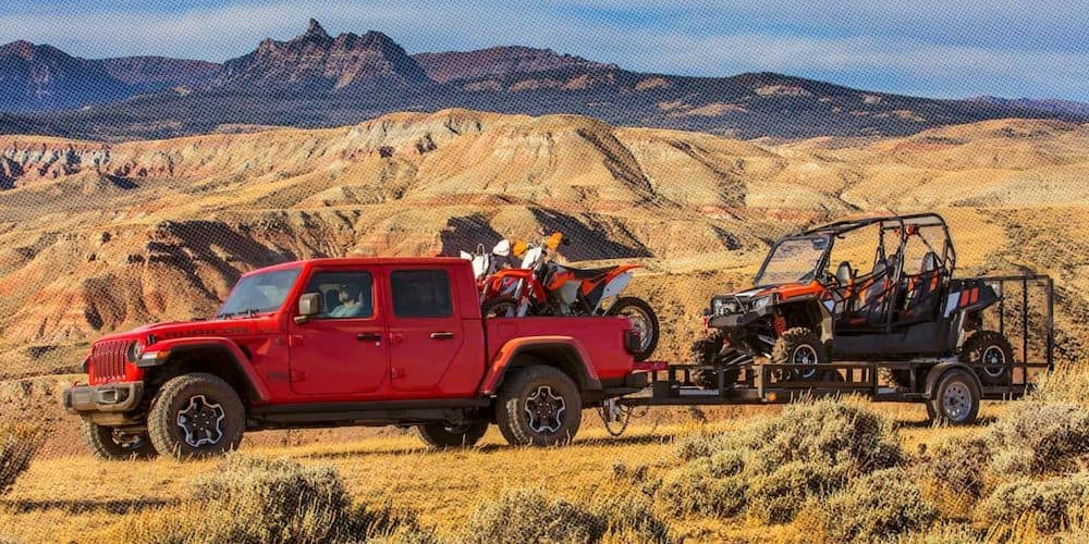 Red 2020 Jeep Gladiator Rubicon Towing Off-Road