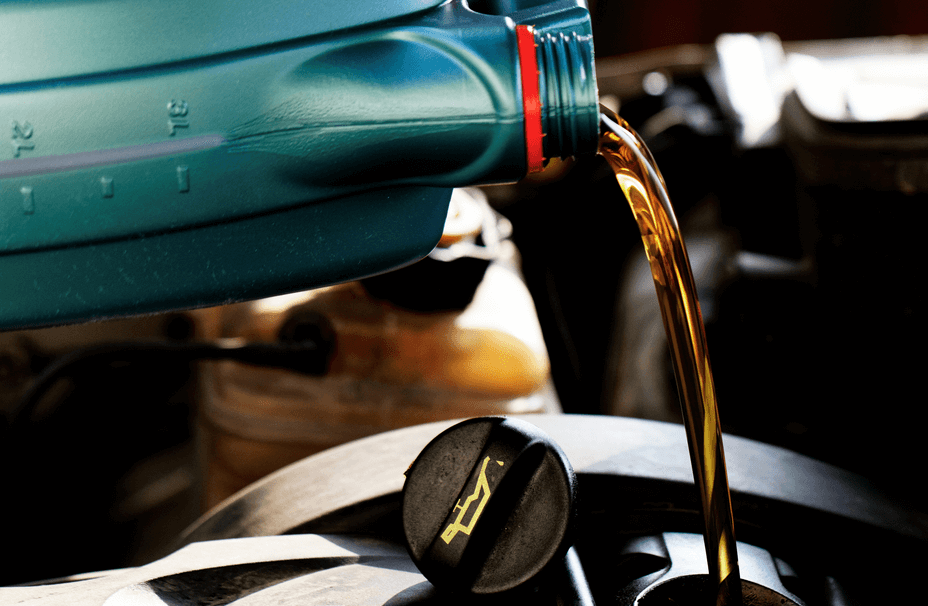 Pouring New Oil into Car Engine