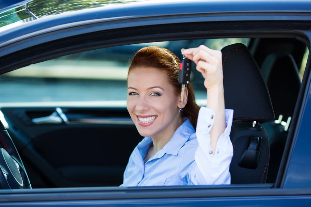 Holding Up Car Keys