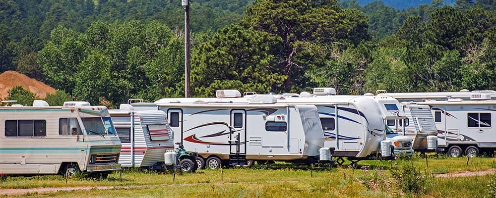 Mountain RV Park with Travel Trailers and Motorhomes. Recreational Vehicles.