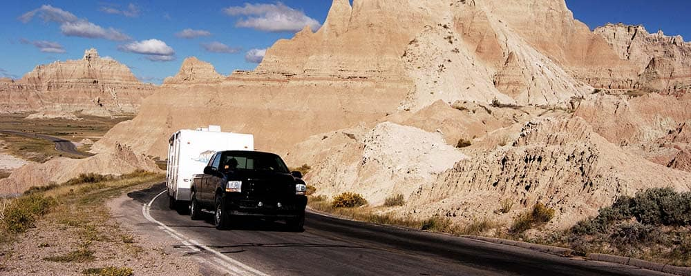 Truck with RV Driving through Badlands
