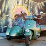 Vespa with sidecar street art