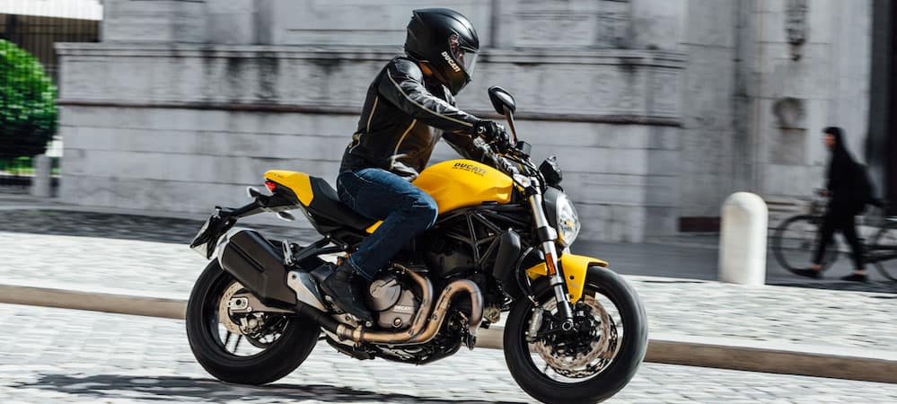 Man riding yellow and black Ducati Monster