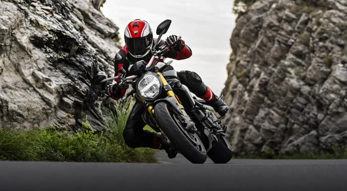 Motorcyclist riding a Ducati Monster 1200 swerving on mountain road