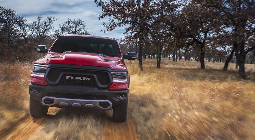 A red 2019 Ram 1500 screams down a southern Texas trail
