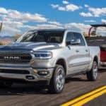 A silver 2019 Ram 1500 tows a boat to a Texas lake
