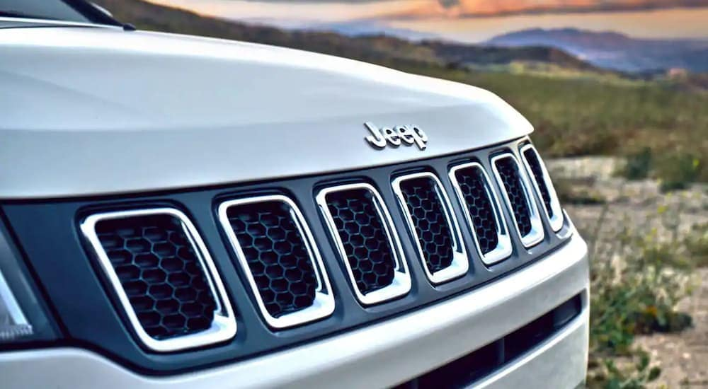 A closeup of a 2019 Jeep Compass front badge from a Jeep dealership near Dallas