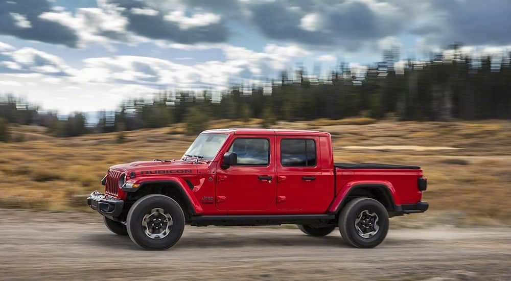 A red 2020 Jeep Gladiator on a off-road test drive from a Jeep dealership near Fort Worth
