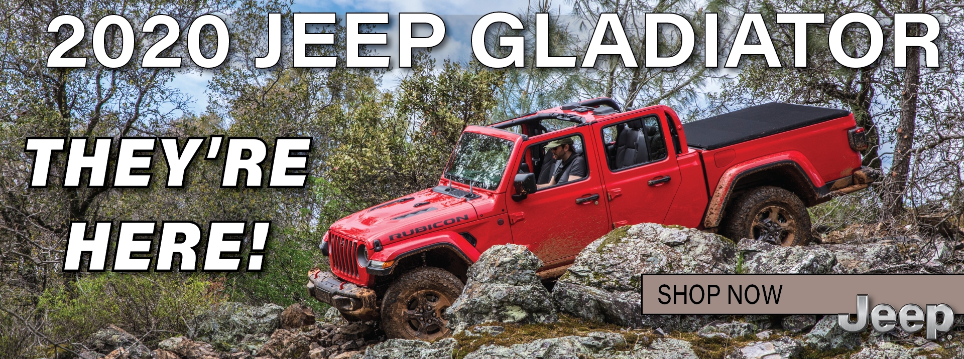 Red 2020 Jeep Gladiator For sale displayed on mountain side rock crawling