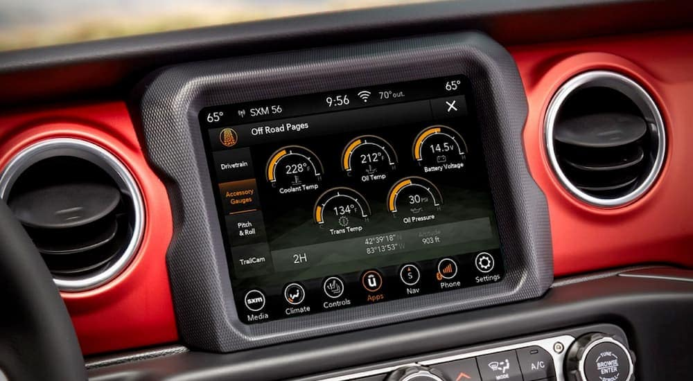 A close up of the entertainment system in the 2020 Jeep Gladiator is displaying vehicle information.