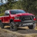 A red 2019 Ram 1500 is off-roading near Ennis, TX.