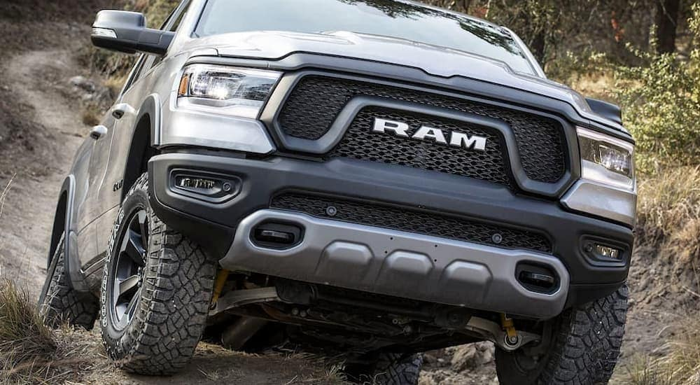 A silver 2019 Ram 1500 is off-road near Ennis, TX showing what lifted trucks can do.
