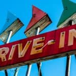 A vintage drive-in sign is shown.