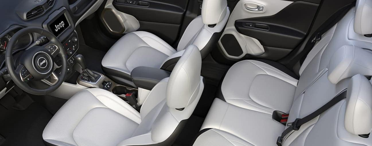 A birds eye view of the white and black leather interior of a 2020 Jeep Renegade is shown.
