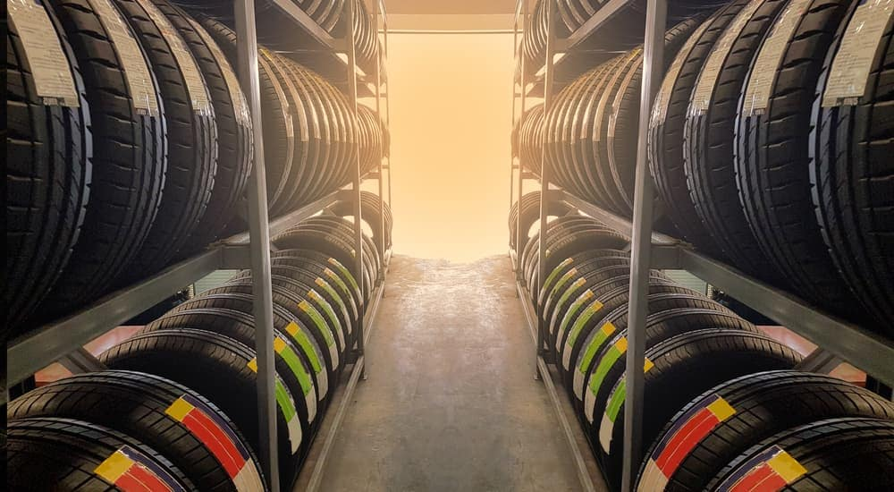 Two large rows of tires are shown at a local tire shop in Ennis, TX.