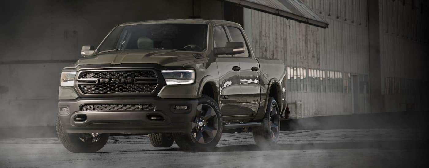 A Gator Green 2020 Ram 1500 Built to Serve edition is parked in front of a dark warehouse near Ennis, TX.