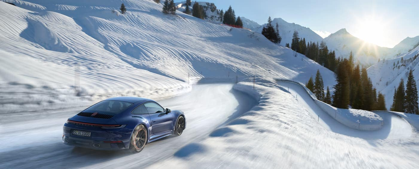 2020 Porsche 911 driving on winter road