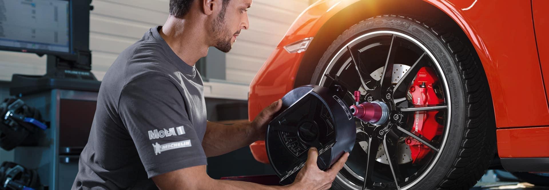 mechanic working on tires