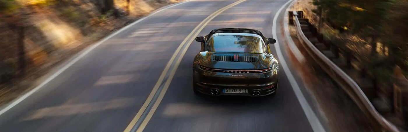 Rear view of a Porsche Macan driving on a road