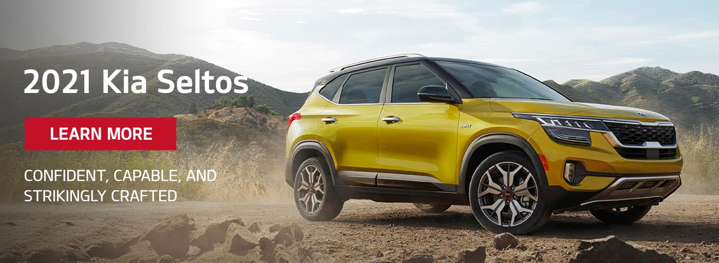 2021 Yellow Kia Seltos with Learn more CTA and