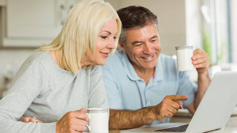 Older Man and Woman Using Computer