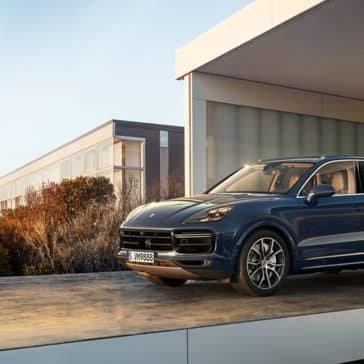 2018 Porsche Cayenne Parked Outside a Home