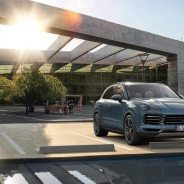 2019 Porsche Cayenne Parked with Woman Activating Features from Phone