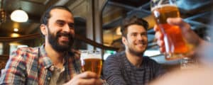 three people drinking craft beer at a brewery