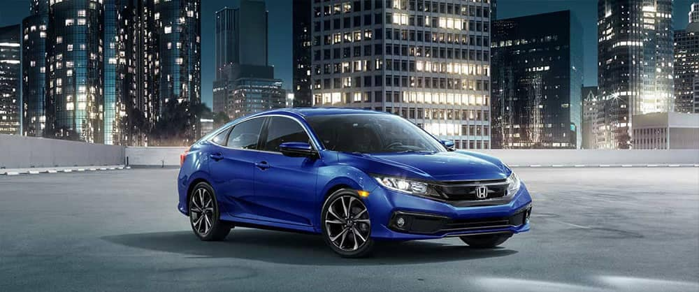 2019 Honda Civic Sedan Parked in Front of City