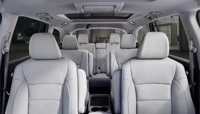 View from front seat of all three rows of seating inside 2020 Honda Pilot