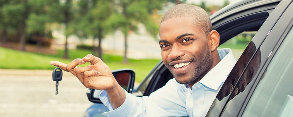 Man Holding Key Outside of Car