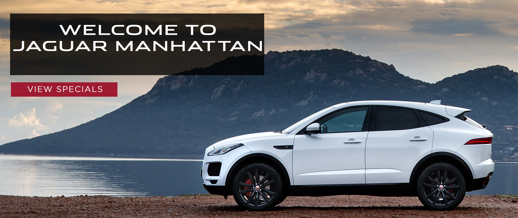 welcome to jaguar manhattan click to view specials white e-pace on mountain and lake background