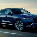 Blue 2020 Jaguar F-PACE driving on highway