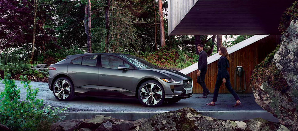 Man and woman walking to parked I-PACE