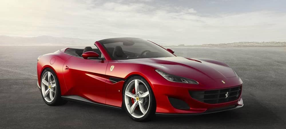 Red Ferrari Portofino against a gray sky