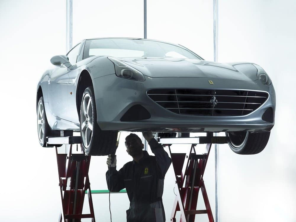 Ferrari Technician Working Beneath Vehicle